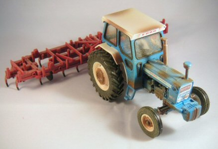Britains Ford tractor with plough towed behind