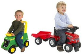 Toddler's sat on ride-on tractors
