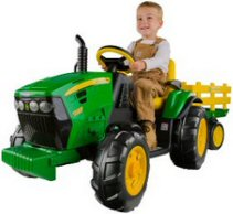 Boy sat on a larger, heavy ride on John Deere
